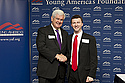 Vincent Spinner shakes hands with Newt Gingrich at a Young America's Foundation Convention.