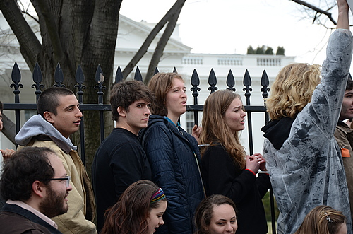 Protestors, including Maud Prineas '17, fourth from left, tie themselves to the White House fence.