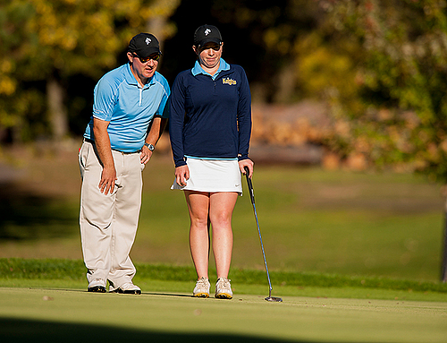 Shannon Holden and head coach Eric Sieger, women's golf action