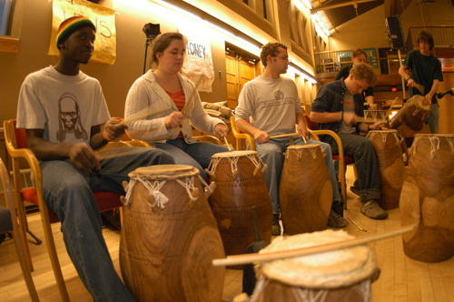 Students play various types of drums