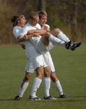 Brian TenHoor (left) and Ross Hamilton (right) celebrate Joe Lindner's (center) game-winning goal.
