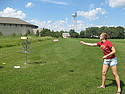 A student plays disc golf
