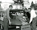 Freshmen student getting help from his parents while moving in during his first week at Carleton in 1959.