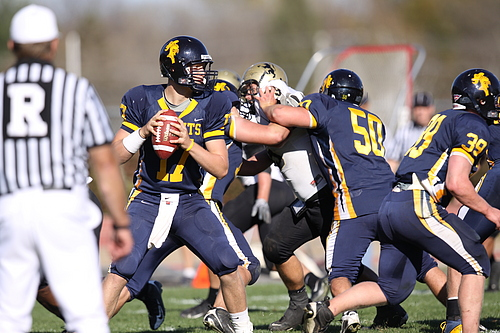 Football game action vs. St. Olaf