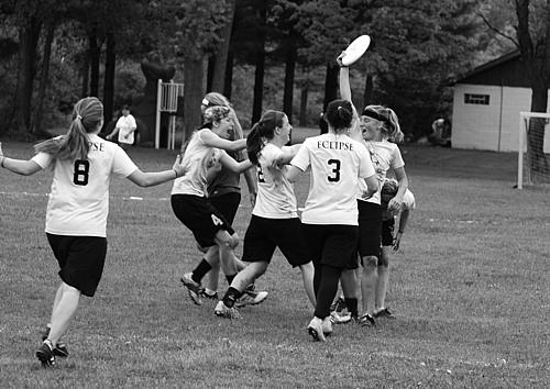 Kate Trenerry '11 celebrates with her teammates after catching the championship-winning point against Williams College at last weekend's USA Ultimate Division III National Tournament.