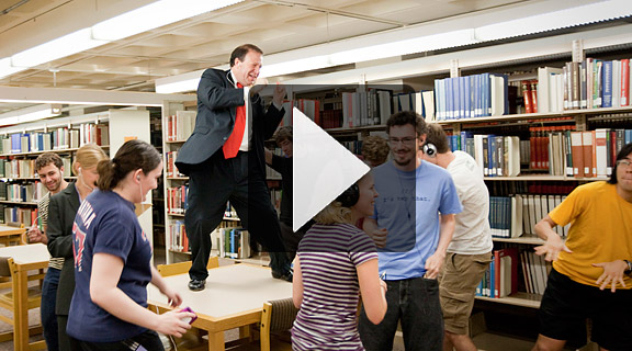 Video still of President Poskanzer and students dancing in the Carleton Library