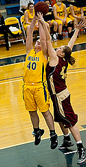 Megan Bakken, women's basketball action