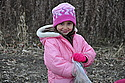 Aya Myint, 5, lends a hand and a smile in the last prairie planting before winter.