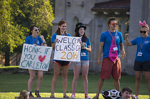 Enthusiastic greeters welcome new students to campus