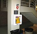 AED mounted in wall enclosure