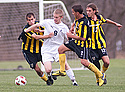 Branden McGarrity '16 shrugs off three Gustavus defenders