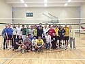 Alumni and current club volleyball players gather in Cowling Gym.