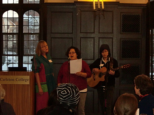 Students and community members sing at the Women's Color Retreat remembrance