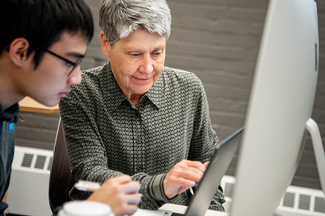 Professor Barbara Allen working with student