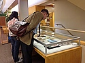 English Professor Timothy Raylor leans in to examine the Library's new exhibit.