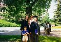 This is Timmy, age 5, with beloved babysitters Bethie Lavin and Amy Luckner, at their Carleton graduation.