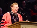 President Rob Oden laughs during his inaugural address