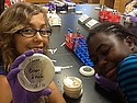 Young scientists growing bacteria collected from common places- like a door knob!