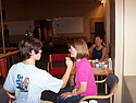 Participants in Carleton's class of 2009 Pre-Frosh Service Trip disaster relief carnival enjoy face painting.