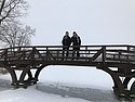On a bridge over a wintry lake