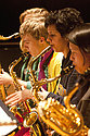 Close-up image of three saxophone players in the Carleton Jazz Ensemble.