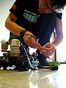 Robotics Team member Adam Steege '08 preps a robot to extinguish a flame.