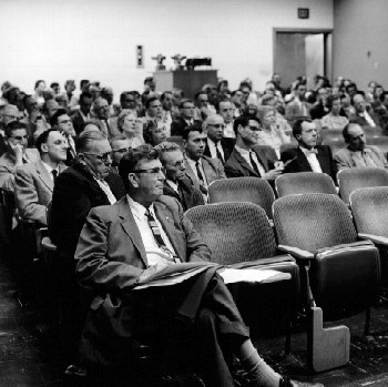 At a faculty meeting in Boliou Hall, 1958-59.