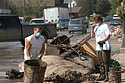 Jon Eidsvaag '08 (right) aids in the cleanup following the flood.