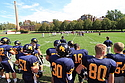 Members of the Carleton football team watch the game against Bethel University.