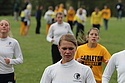 The women's cross country team warms up before the meet.