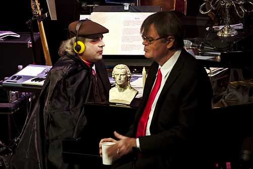 "Schiller appears on the live Halloween broadcast of ""A Prairie Home Companion"" hosted by Garrison Keillor, right, accompanied by Rich Dworsky."