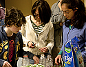 Carleton students and Northfield community members get together during the Earth Week celebration in the Cassat basement to plant flowers in reusable, recycled plastic bottles. Participants were also treated to a performance by a cappella group Exit 69.