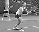 Bridget Doyle '13 competes in a doubles match against St. Catherine University.