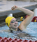 Sohpie Pilhofer celebrates a 1st place finish in the 50 freestyle
