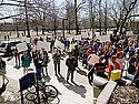 Close to two hundred students attended Friday's rally outside of Sayles, many with handmade signs.