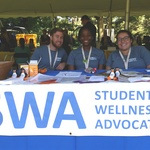 The SWAs tabling health information during the New Student Week Welcome Tent.