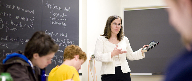 Carleton professor teaching in front of a class.