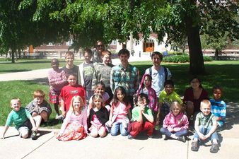 Associate Professor Daniel Groll and philosophy students with elementary students at Greenvale Park.