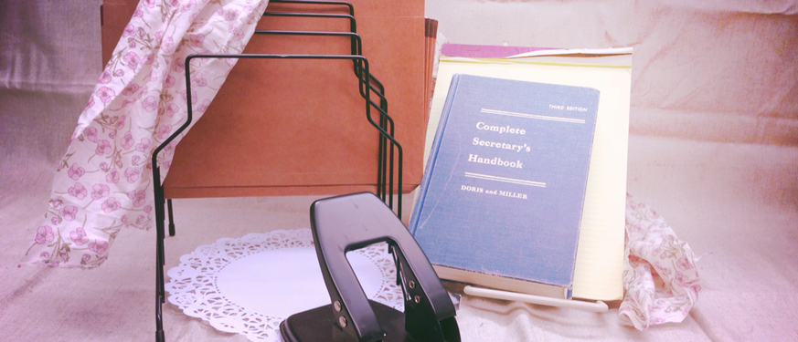 Hole punch, secretary handbook and legal pad