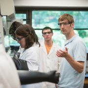 Matt Whited watches over students in the Carleton science research lab.