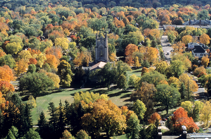 Aerial view of Skinner Memorial Chapel and the Bald Spot from the north, surrounded by dozens of trees in fall colors