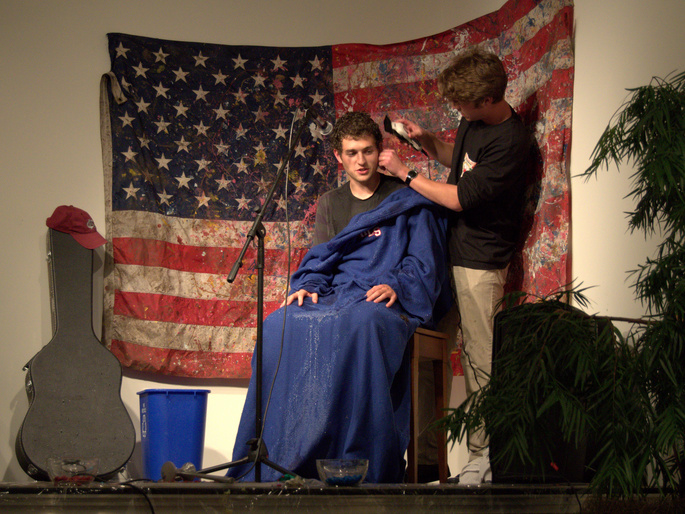 Issac getting a haircut onstage at the Fluxhibition