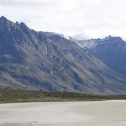 Backdrop of the Patagonian mountains framing a lone hiker