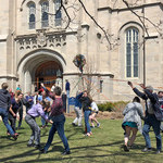 Students and community members dance around a maypole following a service in Skinner Chapel.