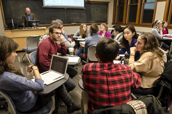 St. Olaf and Carleton students hold a small-group discussion