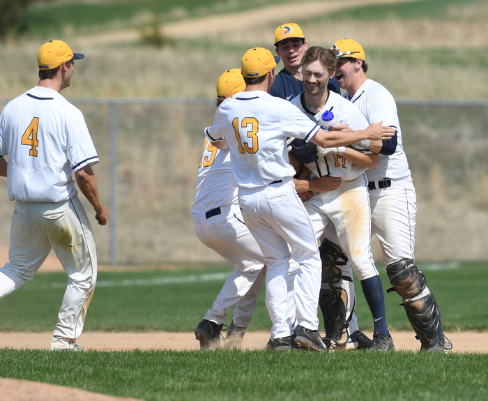 The Knights celebrate Griffin Bolte's game-winning single versus Concordia.