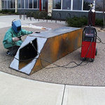 Welding a sculpture outdoors