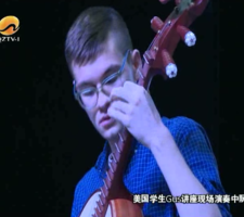 Screen shot captured from Chinese television of a performance by Gus Holley '20.