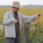 Mark McKone, Research Supervisor, sampling vegetation at Hayden Prairie in Iowa.