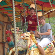 Braden and Brendan riding the carousel at Black Country